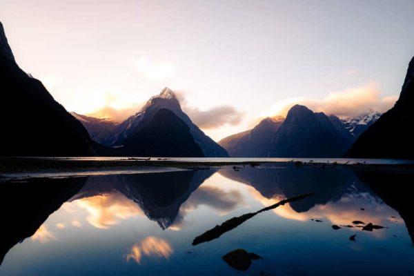 Milford Sound Piopiotahi fiord fiordland nz nouvelle zélande new zealand mountain tasman sea mitre peak water reflect reflet sunset coucher de soleil blue Symétrie nature calm relax